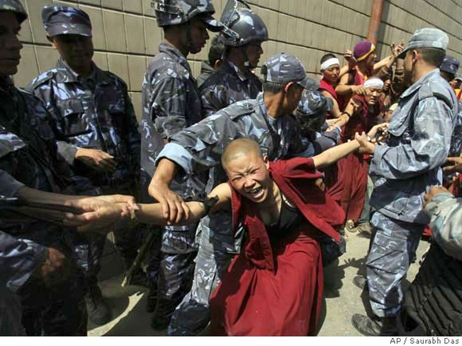 ###Live Caption:Police drag away Tibetan nuns outside the Visa section of Chinese Embassy in Katmandu, Nepal, Sunday March 30, 2008. Policemen baton charged and dragged away scores of exiled Tibetan monks, nuns and people as Tibetans continued their protest against China. (AP Photo/ Saurabh Das)###Caption History:Police drag away Tibetan nuns outside the Visa section of Chinese Embassy in Katmandu, Nepal, Sunday March 30, 2008. Policemen baton charged and dragged away scores of exiled Tibetan monks, nuns and people as Tibetans continued their protest against China. (AP Photo/ Saurabh Das)###Notes:###Special Instructions: Photo: Saurabh Das