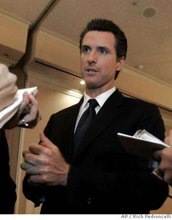 ###Live Caption:San Francisco Mayor Gavin Newsom talks to reporters after his appearance before the Sacramento Press Club in Sacramento, Calif., Tuesday, March 25, 2008. Newsom is criticizing deep cuts to California's Medi-Cal program and says he is considering a lawsuit to reinstate some of the funding. (AP Photo/Rich Pedroncelli)###Caption History:San Francisco Mayor Gavin Newsom talks to reporters after his appearance before the Sacramento Press Club in Sacramento, Calif., Tuesday, March 25, 2008. Newsom is criticizing deep cuts to California's Medi-Cal program and says he is considering a lawsuit to reinstate some of the funding. (AP Photo/Rich Pedroncelli)###Notes:Gavin Newsom###Special Instructions: Photo: Rich Pedroncelli