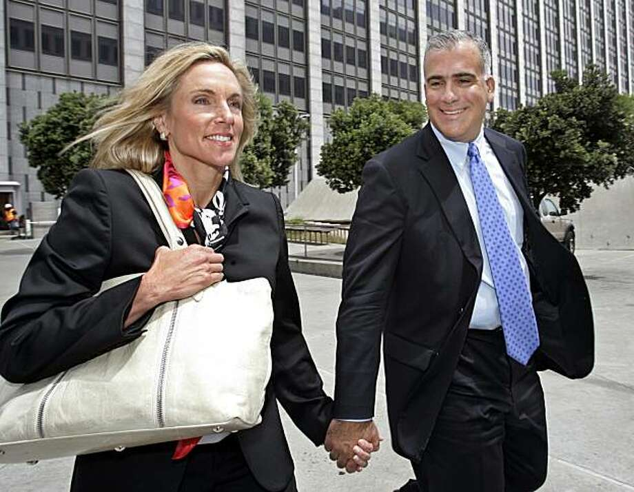 FILE - In this July 26, 2007 file photo, former Brocade Communications Systems Inc. Chief Executive Gregory Reyes and his wife, Penny, leave the federal building in San Francisco. A federal appeals court on Tuesday, Aug. 18, 2009 tossed out the criminal conviction of Gregory Reyes, the first Silicon Valley executive to go to trial in a stock options scandal that triggered charges against at least a dozen executives. (AP Photo/Paul Sakuma, file) Photo: Paul Sakuma, AP