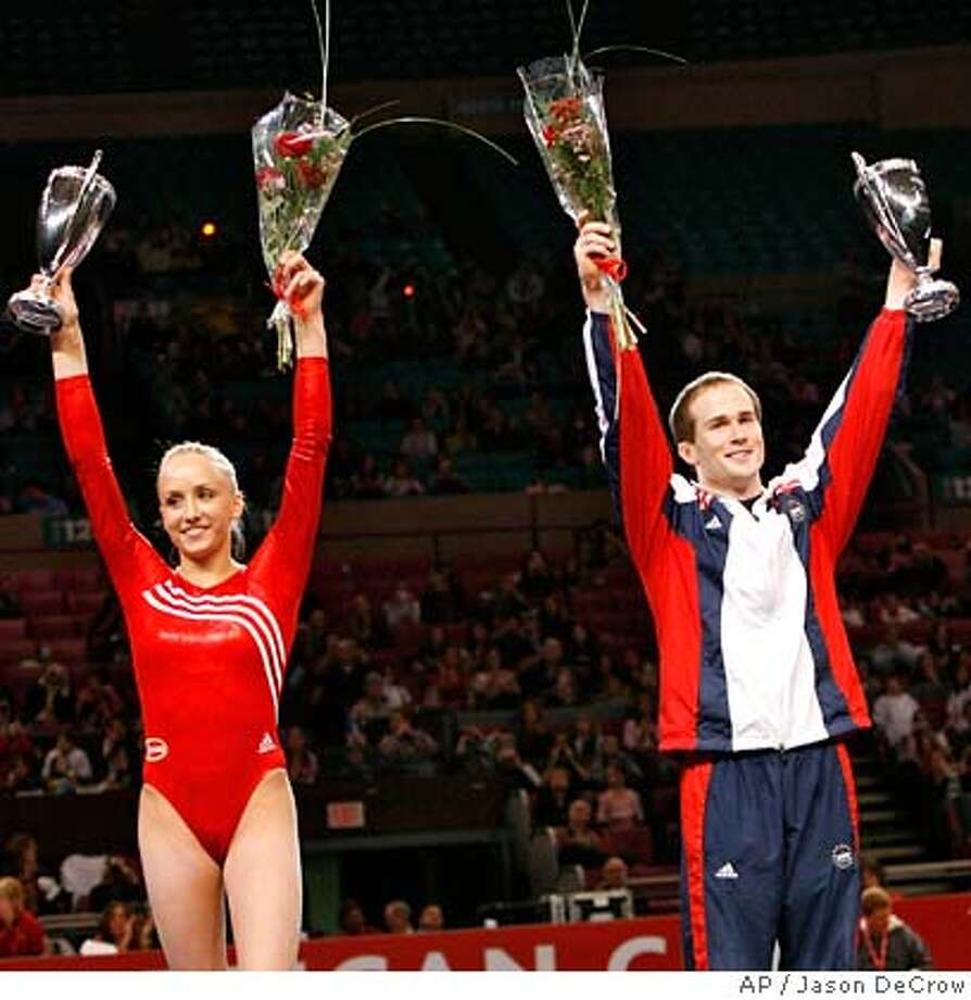 ###Live Caption:Nastia Liukin, left, and Paul Hamm, right, hold up their trophies during the awards ceremony after their wins in the American Cup gymnastics competition Saturday, March 1, 2008, in New York. (AP Photo/Jason DeCrow)###Caption History:###Notes:###Special Instructions: Photo: Jason DeCrow