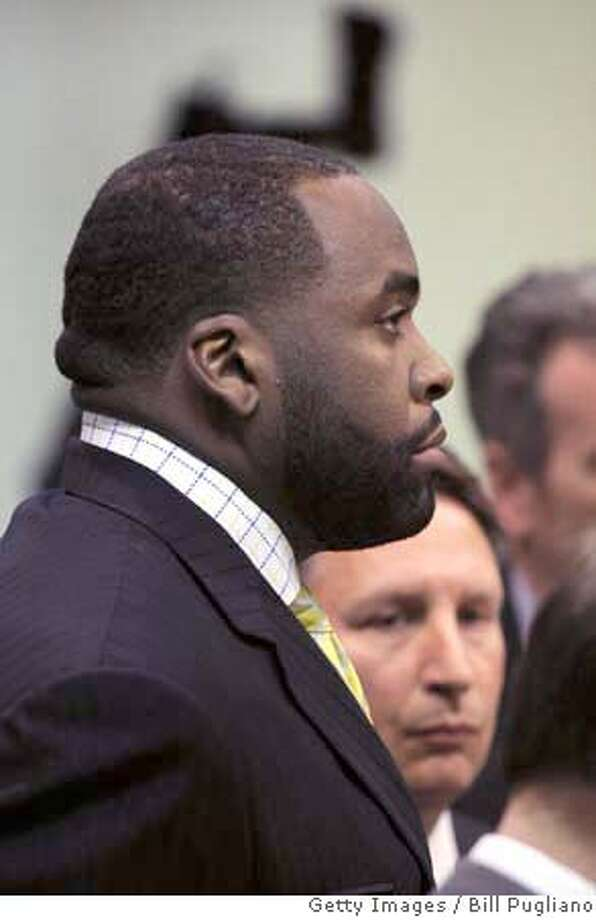 ###Live Caption:DETROIT - MARCH 25: Detroit Mayor Kwame Kilpatrick stands in 36th District Court for his arraignment on multiple felony charges March 25, 2008 in Detroit, Michigan. The charges include perjury and obstruction of justice, all related to a text messaging scandal. (Photo by Bill Pugliano/Getty Images)###Caption History:DETROIT - MARCH 25: Detroit Mayor Kwame Kilpatrick stands in 36th District Court for his arraignment on multiple felony charges March 25, 2008 in Detroit, Michigan. The charges include perjury and obstruction of justice, all related to a text messaging scandal. (Photo by Bill Pugliano/Getty Images)###Notes:Detroit Mayor And His Former Chief Of Staff Arraigned###Special Instructions: Photo: Bill Pugliano