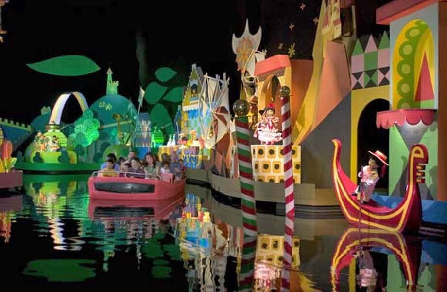 """###Live Caption:TRAVEL DISNEY -- Guests of the Magic Kingdom at Walt Disney World Resort enjoy """"it's a small world,"""" a gentle boat ride through whimsical scenes celebrating the rich diversity of cultures across the globe. This classic Disney attraction recently re-opened after getting an extreme makeover. As part of the Happiest Celebration on Earth, an 18-month salute to 50 years of magic at Disney destinations around the world, Walt Disney Imagineers have refreshed and enhanced the beloved attraction to make it an even more enchanting experience where families can make magical new memories together. In addition to the renovation work, the celebrated """"clockwork"""" art from famed Disney artist Mary Blair that dons the facade of the original Disneyland attraction has been added to the Walt Disney World attraction's main inner queue area. The attraction first opened at the 1964 New York World's Fair, was soon after featured at Disneyland in California and was an original attraction at the opening of Walt Disney World in 1971. 0319AV_8099GD Ran on: 03-11-2007 A Goofy grin: Disney characters are still one of the biggest draws for young visitors, even if this does leave some wondering why Goofy can talk and Pluto can't.###Caption History:TRAVEL DISNEY -- Guests of the Magic Kingdom at Walt Disney World Resort enjoy """"it's a small world,"""" a gentle boat ride through whimsical scenes celebrating the rich diversity of cultures across the globe. This classic Disney attraction recently re-opened after getting an extreme makeover. As part of the Happiest Celebration on Earth, an 18-month salute to 50 years of magic at Disney destinations around the world, Walt Disney Imagineers have refreshed and enhanced the beloved attraction to make it an even more enchanting experience where families can make magical new memories together. In addition to the renovation work, the celebrated """"clockwork"""" art from famed Disney artist Mary Blair that dons the facade of the origin Photo: Na"""