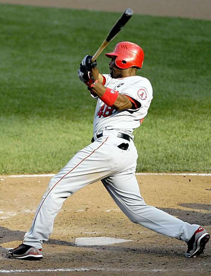 Los Angeles Angels' Torii Hunter follows his go-ahead RBI-single during the 13th inning of a baseball game against the Baltimore Orioles, Sunday, Aug. 16, 2009, in Baltimore. (AP Photo/Rob Carr) Photo: Rob Carr, AP
