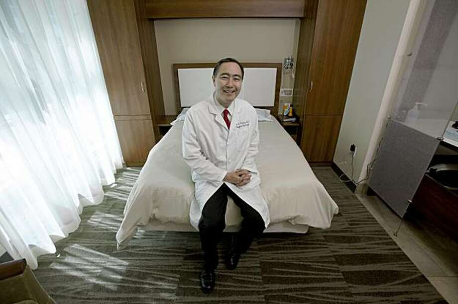Dr. Clete Kushida Director for Human Sleep Research, poses for a photo inside one of the sleep rooms of the Stanford's Center for Human Sleep Research August 5, 2009 in Redwood City, California.  (Photography by David Paul Morris / Special to the Chronicle) Photo: David Paul Morris, Special To The Chronicle