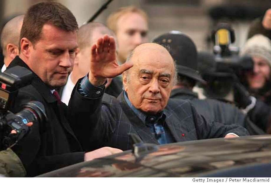 ###Live Caption:LONDON - FEBRUARY 18: Harrods owner Mohamed Al Fayed waves as he leaves the High Court on February 18, 2008 in london. Mr Al Fayed, who's son Dodi was killled with Diana, Princess of Wales in Paris in 1997, gave evidence to the inquest into their deaths. (Photo by Peter Macdiarmid/Getty Images)###Caption History:LONDON - FEBRUARY 18: Harrods owner Mohamed Al Fayed waves as he leaves the High Court on February 18, 2008 in london. Mr Al Fayed, who's son Dodi was killled with Diana, Princess of Wales in Paris in 1997, gave evidence to the inquest into their deaths. (Photo by Peter Macdiarmid/Getty Images)  Ran on: 02-19-2008  Mohammed al-Fayed (center) leaves a London court Monday after testifying about the deaths of Princess Diana and his son Dodi.  Ran on: 02-19-2008###Notes:Mohammed Al Fayed Gives Evidence At Diana Inquest###Special Instructions: Photo: Peter Macdiarmid