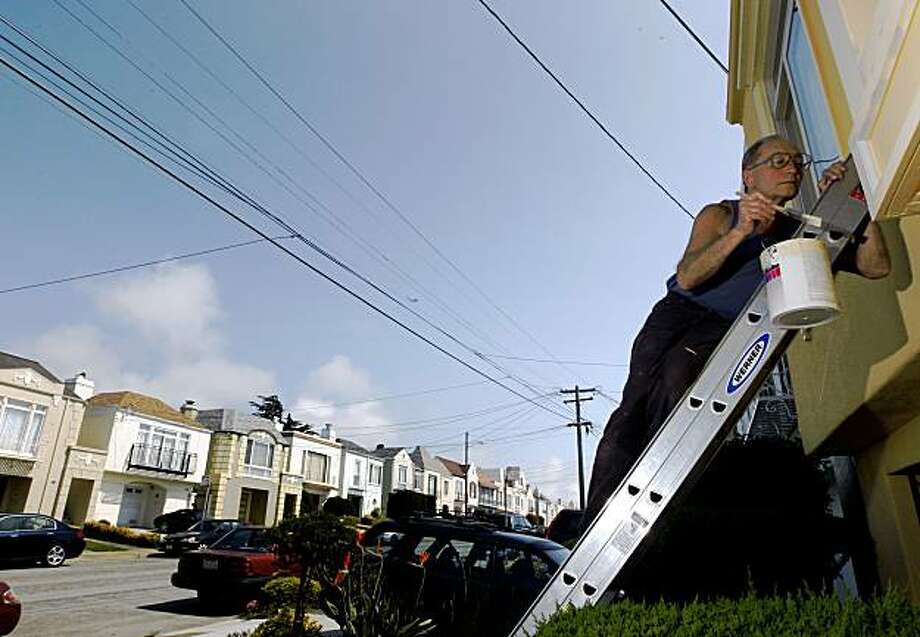 Anatoly Iskoz paints his house on 33rd Street in San Francisco's Sunset District on August 7, 2009. Iskoz isn't concerned about the recent rash of raided pot-growing operations in his neighborhood because he says most of his neighbors are conservative and he doubts they're growing pot. Photo: Lance Iversen, The Chronicle