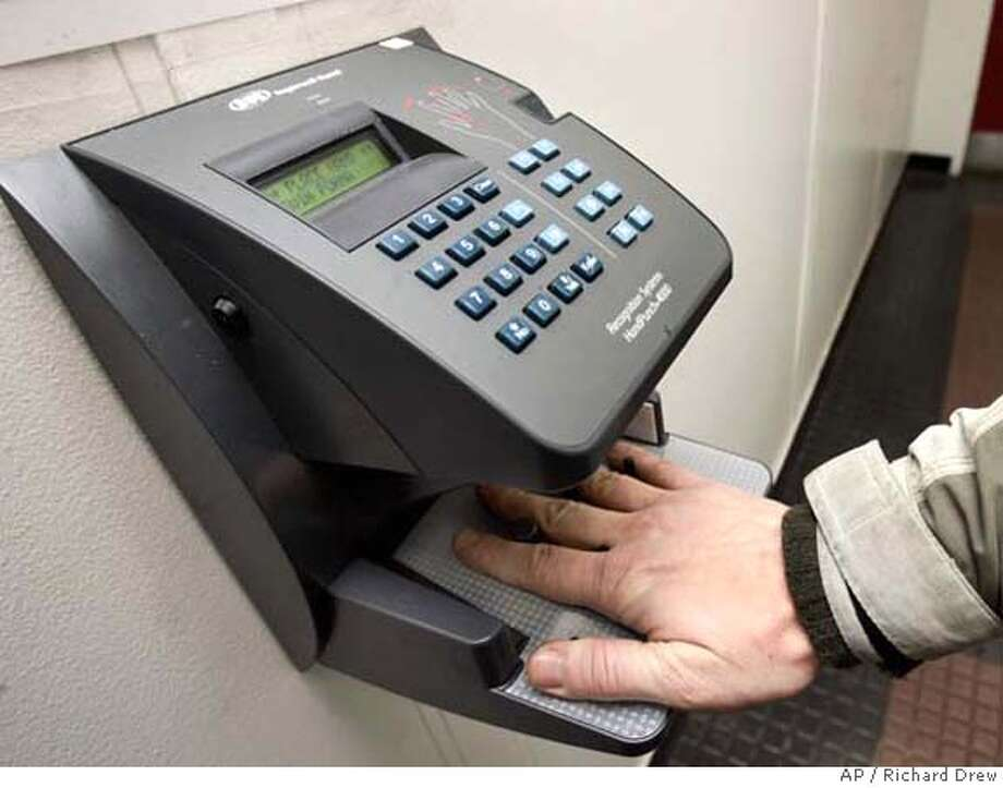 ###Live Caption:An employee of the New York City Parks Dept. uses a palm scanner as he arrives for work, in the Queens borough of New York Wednesday March 26, 2008. At workplaces in Birmingham, Ala., Chicago, New York and elsewhere, more employees are starting their days by pressing a hand or finger to a scanner that logs the precise time of their arrival. Manufacturers say these systems improve efficiency and streamline payroll operations, but some employees see the programs as creepy and bureaucratic. (AP Photo/Richard Drew)###Caption History:An employee of the New York City Parks Dept. uses a palm scanner as he arrives for work, in the Queens borough of New York Wednesday March 26, 2008. At workplaces in Birmingham, Ala., Chicago, New York and elsewhere, more employees are starting their days by pressing a hand or finger to a scanner that logs the precise time of their arrival. Manufacturers say these systems improve efficiency and streamline payroll operations, but some employees see the programs as creepy and bureaucratic. (AP Photo/Richard Drew)###Notes:###Special Instructions: Photo: RICHARD DREW