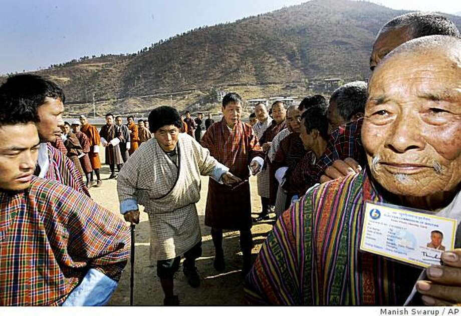 Bhutanese people queue up to cast their votes outside a polling station in Thimphu, Bhutan, Monday, March 24, 2008. The secluded Himalayan nation of Bhutan was on its way to becoming the worlds newest democracy on Monday, as the voters cast ballot to select a new parliament and end more than a century of absolute monarchy. (AP Photo/Manish Swarup) Photo: Manish Swarup, AP