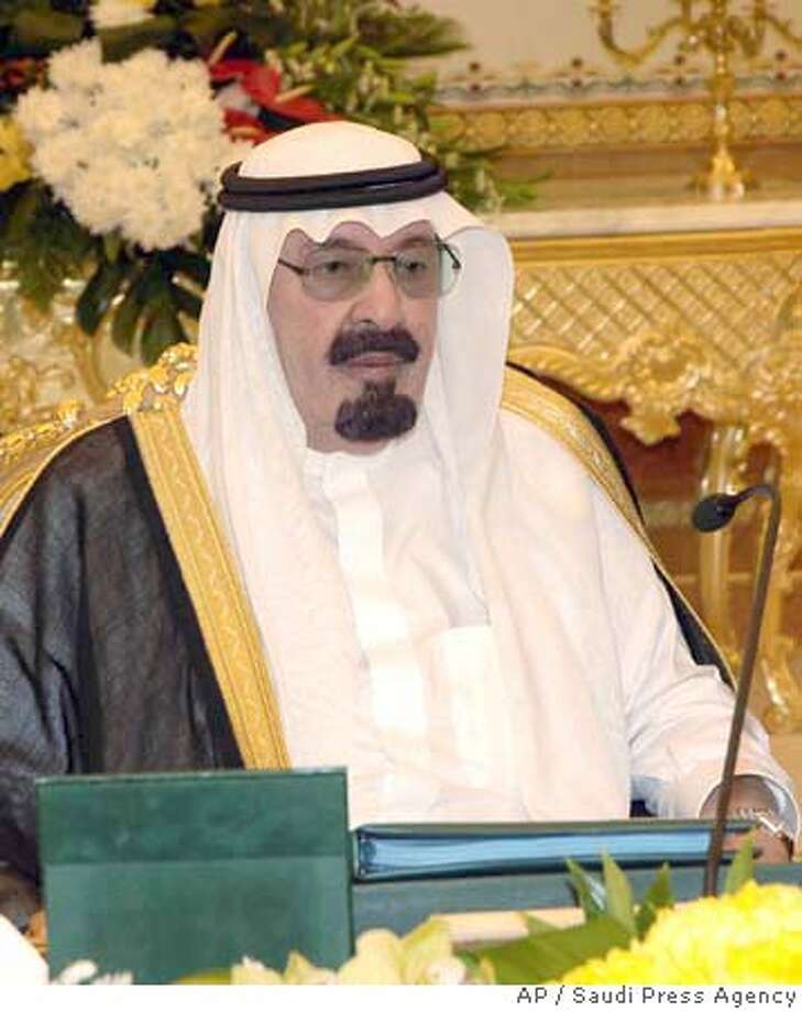 ###Live Caption:In this image released by the Saudi Press Agency, Saudi King Abdullah talks during his meeting with his ministerial cabinet in Riyadh, Saudi Arabia Monday, March 24, 2008. Saudi Arabia's ambassador to the Arab League said Monday that he will represent his country at the upcoming Arab summit in Damascus instead of the Saudi king. The announcement by Ahmad al-Qattan was a big blow to Syrian attempts to ensure high-level representation at the first Arab summit held in the country. The meeting is normally attended by the heads of state of the participating Arab countries. (AP Photo/Saudi Press Agency)###Caption History:In this image released by the Saudi Press Agency, Saudi King Abdullah talks during his meeting with his ministerial cabinet in Riyadh, Saudi Arabia Monday, March 24, 2008. Saudi Arabia's ambassador to the Arab League said Monday that he will represent his country at the upcoming Arab summit in Damascus instead of the Saudi king. The announcement by Ahmad al-Qattan was a big blow to Syrian attempts to ensure high-level representation at the first Arab summit held in the country. The meeting is normally attended by the heads of state of the participating Arab countries. (AP Photo/Saudi Press Agency)###Notes:###Special Instructions:IMAGE RELEASED BY THE SAUDI PRESS AGENCY AP PROVIDES ACCESS TO THIS PUBLICLY DISTRIBUTED HANDOUT PHOTO. THE COPYRIGHT IS OWNED BY A THIRD PARTY. Photo: SAUDI PRESS AGENCY