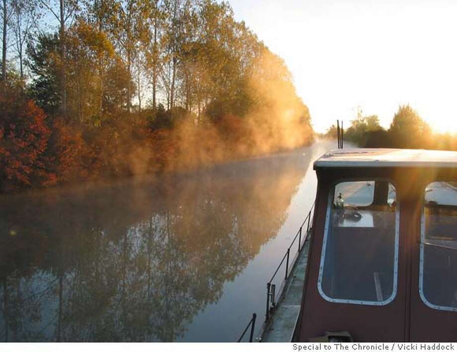 Morning mist rises over Kate Hill�s home, the barge the Julia Hoyt, at its homeport on the Canal des Deux-Mers in the South of France. Photo by Vicki Haddock / Ran on: 03-30-2008  Mist rises over Kate Hill's barge Julia Hoyt on the Canal des Deux-Mers in France.  Ran on: 03-30-2008 Photo: Vicki Haddock