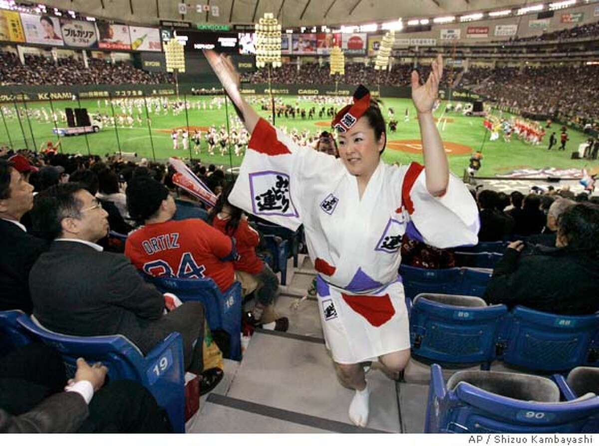 """""""Awaodori,"""" a Japanese traditional dance, is performed in spectators seats during an opening ceremony before the Major League Baseball regular season opener between the Boston Red Sox and the Oakland Athletics at Tokyo Dome in Tokyo, Japan, Tuesday, March 25, 2008. (AP Photo/Shizuo Kambayashi)"""