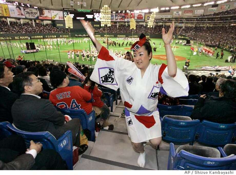 """Awaodori,"" a Japanese traditional dance, is performed in spectators seats during an opening ceremony before the Major League Baseball regular season opener between the Boston Red Sox and the Oakland Athletics at Tokyo Dome in Tokyo, Japan, Tuesday, March 25, 2008. (AP Photo/Shizuo Kambayashi) Photo: Shizuo Kambayashi"