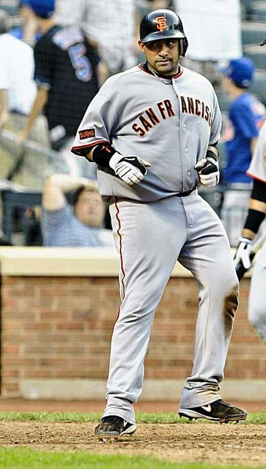 San Francisco Giants' Bengie Molina (1) arrives at home plate after hitting a home run during the 10th inning of a baseball game against the New York Mets Saturday, Aug. 15, 2009,  in New York. The Giants won the game 5-4 in 10 innings.  (AP Photo/Frank Franklin II) Photo: Frank Franklin II, AP