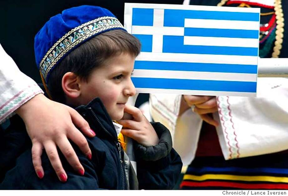Stelios Stavropoulos age 3, from Sacramento patiently waits for the parade to start while standing on a flood next to the Greek National Flag. Hundreds of members of the Greek-American community from Northern California turned out Saturday March 29, 2008 to celebrate their heritage by taking part in the annual Greek Cultural Heritage Parade in San Francisco. Photo By Lance Iversen / San Francisco Chronicle. Photo: LANCE IVERSEN