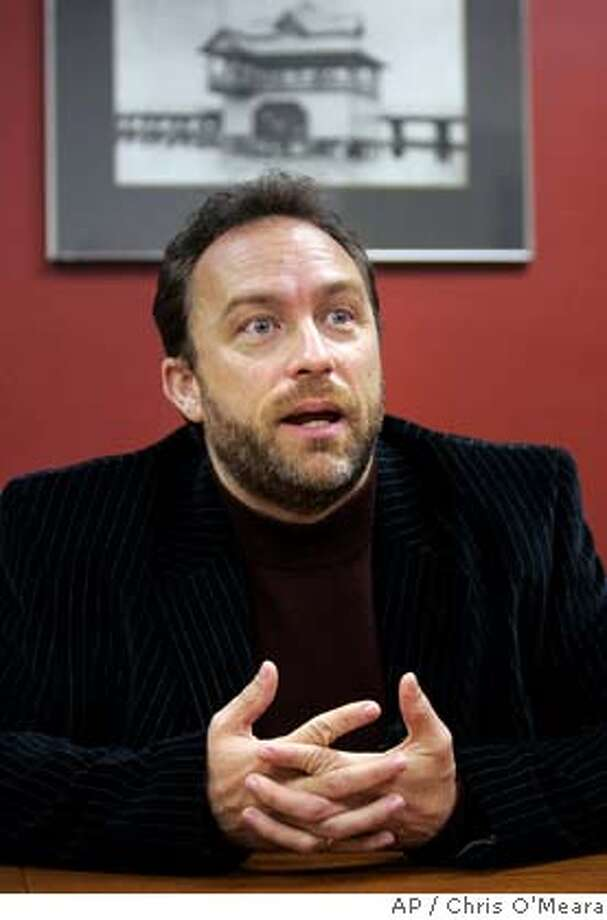 """** ADVANCE FOR FRIDAY, MARCH 21 - FILE ** Jimmy Wales, founder of Wikipedia, answers a question during an interview with the Associated Press in St. Petersburg, Fla. in this June 29, 2007 file photo. With 2 million articles in English alone, Wikipedia, the Internet encyclopedia """"anyone can edit,"""" stormed the Web's top ranks through the work of unpaid volunteers and the assistance of donors. But that means Wikipedia has far less financial clout than its Web peers, and doing almost anything to improve that situation invites scrutiny from the same community that proudly generates the content. (AP Photo/Chris O'Meara, file) Photo: Chris O'Meara"""