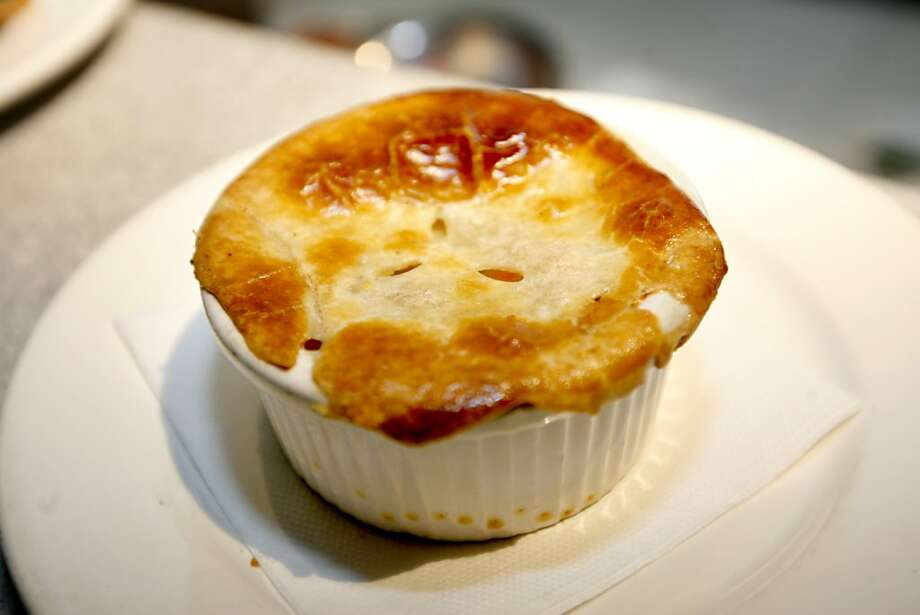 A Kid Sized Chicken Pot Pie, served on Sunday, kids' night at Luella, a restaurant in San Francisco, Calif. on Sunday March 16, 2008. Photo by Katy Raddatz / San Francisco Chronicle Ran on: 03-26-2008 Celebrating at Chenery Park: Tuesday kids' night coincided with Olivia Spreen's fourth birthday. To her left are godfather Torbin Bullock, and brother Carter, 7. At right, Chenery Park's fried chicken. Photo: Katy Raddatz, SFC