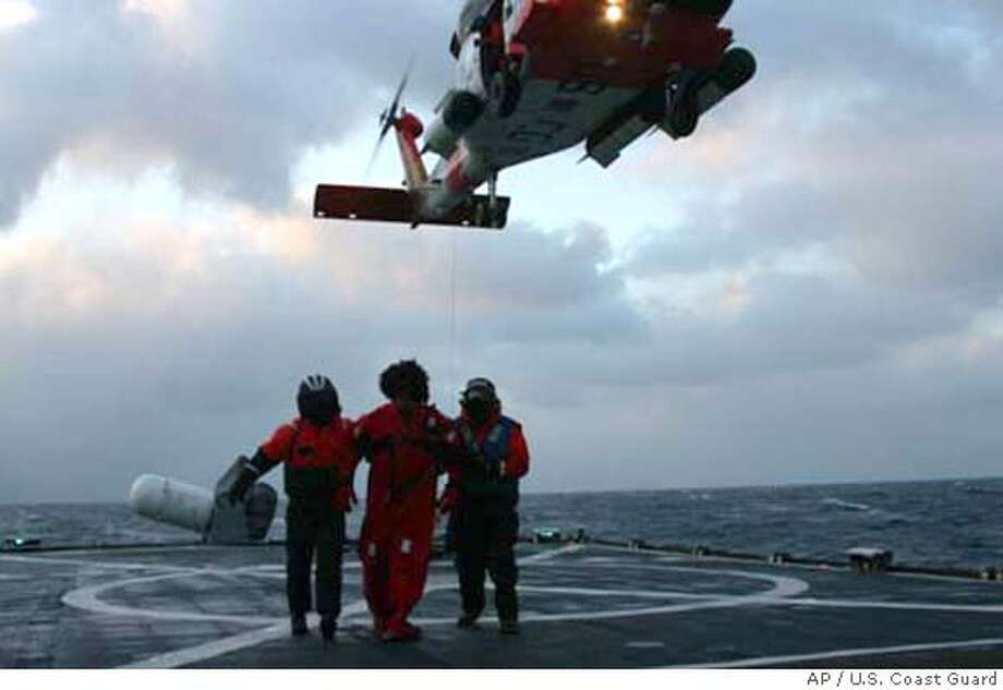 ###Live Caption:This photo provided by the U. S. Coast Guard shows a crew member of the Alaska Ranger taken on board the Coast Guard Cutter Munro on Sunday, March 23, 2008. Four crew members died Sunday and another was missing after a Seattle-based fishing boat began sinking in high seas off Alaska's Aleutian Islands, the Coast Guard said. The dead were among 47 crew members who abandoned ship after the 184-foot (56-meter) Alaska Ranger developed problems. (AP Photo/U.S. Coast Guard)###Caption History:This photo provided by the U. S. Coast Guard shows a crew member of the Alaska Ranger taken on board the Coast Guard Cutter Munro on Sunday, March 23, 2008. Four crew members died Sunday and another was missing after a Seattle-based fishing boat began sinking in high seas off Alaska's Aleutian Islands, the Coast Guard said. The dead were among 47 crew members who abandoned ship after the 184-foot (56-meter) Alaska Ranger developed problems. (AP Photo/U.S. Coast Guard)###Notes:###Special Instructions:LARGEST SIZE IMAGE AVAILABLE AP provides access to this publicly distributed HANDOUT photo to be used only to illustrate news reporting or commentary on the facts or events depicted in this image. Photo: U.S. Coast Guard