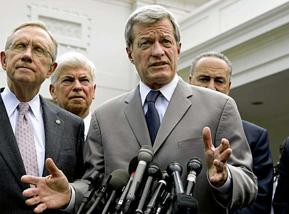 FILE - In this Tuesday, Aug. 4, 2009 file picture, Senate Finance Committee Chairman Sen. Max Baucus, D-Mont., center, talks to journalists after lunch with President Obama and other Democratic senators, outside the White House in Washington. Joining him, from left are, Senate Majority Leader Harry Reid of Nev., Senate Banking Committee Chairman Sen. Christopher Dodd, D-Conn., and Sen. Charles Schumer, D-N.Y. (AP Photo/J. Scott Applewhite/file) Photo: J. Scott Applewhite, AP