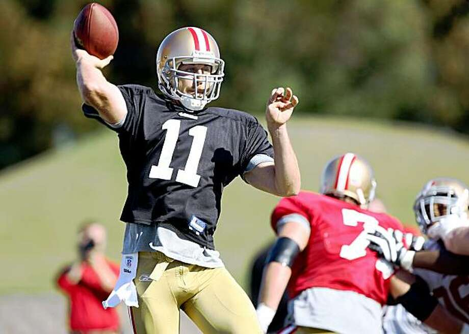 SANTA CLARA, CA - AUGUST 04:  Quarterback Alex Smith #11 throws the ball during the 49ers training camp at their practice facilities on August 4, 2009 in Santa Clara, California.  (Photo by Jed Jacobsohn/Getty Images) Photo: Jed Jacobsohn, Getty Images