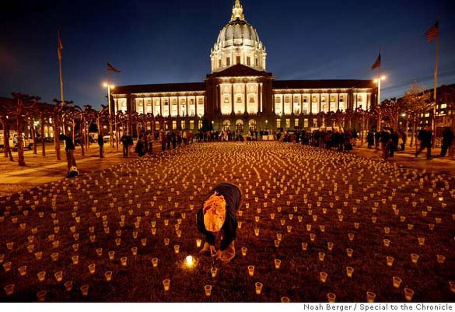 ###Live Caption:Dana Dillworth of Brisbane lights a candle during a peace vigil commemorating the 4,000 soldiers killed in Iraq, on Monday, March 24, 2008, at San Francisco's Civic Center Plaza. The wind prevented most candles from glowing as of 8:30 p.  Photo by Noah Berger / Special to the Chronicle###Caption History:Dana Dillworth of Brisbane lights a candle during a peace vigil commemorating the 4,000 soldiers killed in Iraq, on Monday, March 24, 2008, at San Francisco�s Civic Center Plaza. The wind prevented most candles from glowing as of 8:30 p.  Photo by Noah Berger / Special to the Chronicle###Notes:###Special Instructions: Photo: Noah Berger