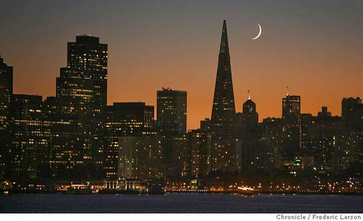 ###Live Caption:If you can't seem to leave the city without one last look over your shoulder, the perfect vista is the first exit, Treasure Island. It seem like their is only a few evenings of the year you can capture a postcard setting of the crescent moon topping off a what is already a stunning skyline.###Caption History: If you can't seem to leave the city without one last look over your shoulder, the perfect vista is the first exit, Treasure Island. It seem like their is only a few evenings of the year you can capture a postcard setting of the crescent moon topping off a what is already a stunning skyline. Both the sun and moon set hand and hand from each other as making a curtain call to all who took the time to watch. The crescent moon set over the city skyline seen from Treasure Island while the sun set beyond the Golden Gate Bridge. 10/14/07 {Photographed by Frederic Larson}###Notes:###Special Instructions:MANDATORY CREDIT FOR PHOTOGRAPHER AND SAN FRANCISCO CHRONICLE/NO SALES-MAGS OUT