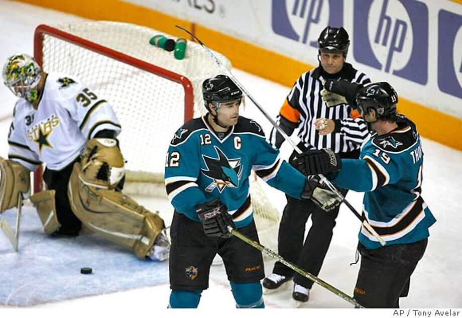 ###Live Caption:San Jose Sharks Joe Thornton, right, celebrates with teammate Patrick Marleau, center, after Thornton scored the winning goal against Dallas Stars goalie Marty Turco, left, during overtime of an NHL hockey game in San Jose, Calif., Thursday, Mar. 27, 2008. San Jose won 3-2 in overtime. (AP Photo/Tony Avelar)###Caption History:San Jose Sharks Joe Thornton, right, celebrates with teammate Patrick Marleau, center, after Thornton scored the winning goal against Dallas Stars goalie Marty Turco, left, during overtime of an NHL hockey game in San Jose, Calif., Thursday, Mar. 27, 2008. San Jose won 3-2 in overtime. (AP Photo/Tony Avelar)###Notes:Patrick Marleau, Joe Thornton, Marty Turco###Special Instructions:EFE OUT Photo: Tony Avelar