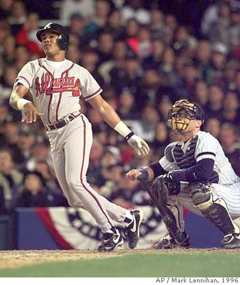 ###Live Caption:sfgf###Caption History:** FILE ** Andruw Jones watches his three-run home run in the third inning of Game 1 of the World Series against the New York Yankees in New York, in this Oct. 20, 1996 file photo. At right is Yankees catcher Jim Leyritz. The Atlanta Braves are cutting ties with Jones, saying they can't afford to keep the perennial Gold Glove center fielder who's spent his entire career with the organization. (AP Photo/Mark Lennihan)  Ran on: 10-07-2007  Andruw Jones is assured of going down as one of the game's greatest center fielders by virtue of nine straight Gold Gloves, but he's done in Atlanta.###Notes:###Special Instructions:OCT. 20, 1996 FILE PHOTO. EFE OUT Photo: MARK LENNIHAN