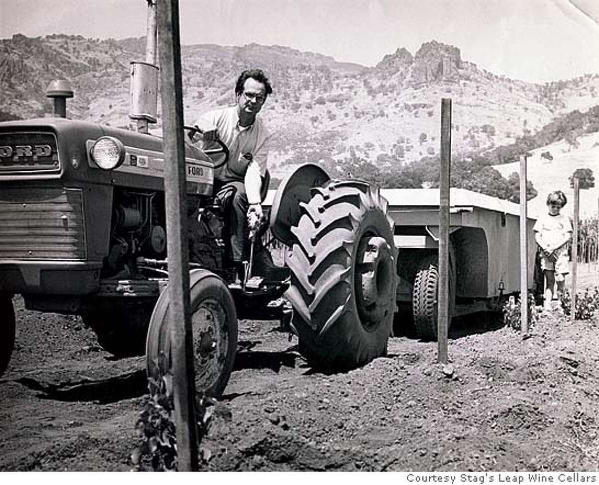 ###Live Caption:Warren Winiarski on a tractor back in 1970 when he was developing Stag's Leap Vineyard. The young boy in the photo is Stephen Winiarski, Warren's son. Photo courtesy Stag's Leap Wine Cellars###Caption History:Warren Winiarski on a tractor back in 1970 when he was developing Stag's Leap Vineyard. The young boy in the photo is Stephen Winiarski, Warren's son. Photo courtesy Stag's Leap Wine Cellars###Notes:###Special Instructions: