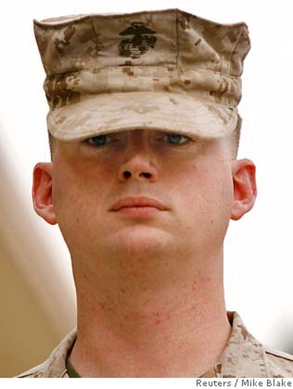 ###Live Caption:Lance Corporal Stephen B. Tatum arrives for his Article 32 hearing of the Haditha investigation at U.S. Marine Corps Camp Pendleton, California in this July 16, 2007 file photo. Charges were dismissed on March 28, 2008 against Tatum, accused of involuntary manslaughter and aggravated assault in the 2005 shooting deaths of two dozen unarmed Iraqi civilians at Haditha REUTERS/Mike Blake/Files (UNITED STATES)###Caption History:Lance Corporal Stephen B. Tatum arrives for his Article 32 hearing of the Haditha investigation at U.S. Marine Corps Camp Pendleton, California in this July 16, 2007 file photo. Charges were dismissed on March 28, 2008 against Tatum, accused of involuntary manslaughter and aggravated assault in the 2005 shooting deaths of two dozen unarmed Iraqi civilians at Haditha REUTERS/Mike Blake/Files (UNITED STATES)###Notes:File photo of Lance Corporal Tatum at US Marine Corps Camp Pendleton###Special Instructions:0