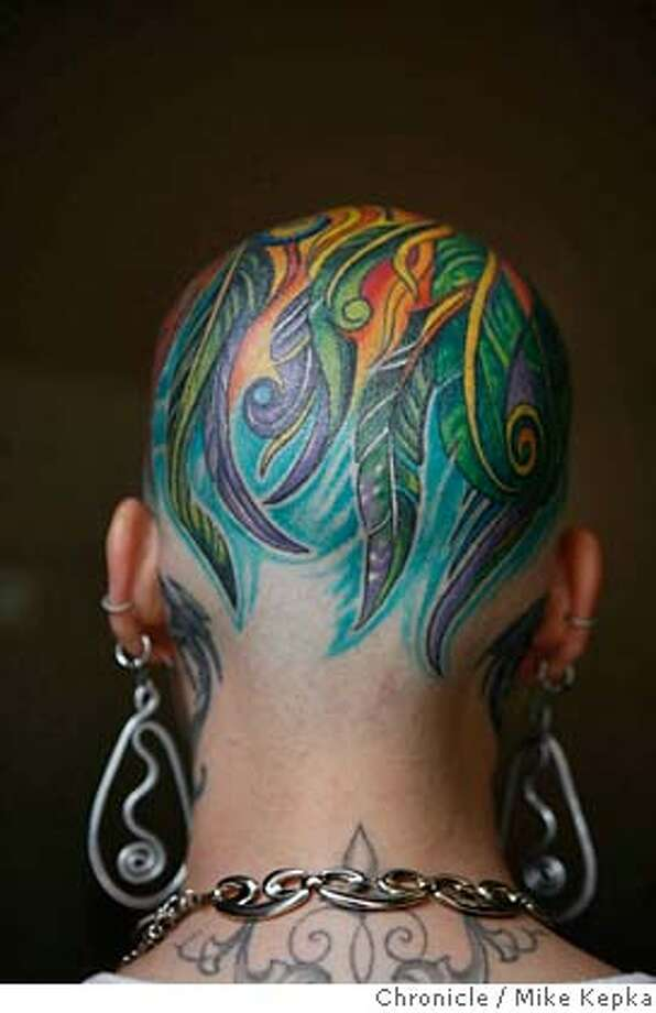 ###Live Caption:Cristina Gutierrez, of Daly City Calif. shows off a head tattoo, a phoenix that symbolizes a rebirth after she won a battle with cancer, at the annual Tattoo and Body Art Expo at the Cow Palace on Friday, March 28, 2008 in Daly City , Calif. Photo by Mike Kepka/ San Francisco Chronicle###Caption History:Cristina Gutierrez, of Daly City Calif. shows off a head tattoo, a phoenix that symbolizes a rebirth after she won a battle with cancer, at the annual Tattoo and Body Art Expo at the Cow Palace on Friday, March 28, 2008 in Daly City , Calif. Photo by Mike Kepka/ San Francisco Chronicle###Notes:(cq) Cristina Gutierrez (yes with no H. She confirmed this)###Special Instructions:MANDATORY CREDIT FOR PHOTOG AND SAN FRANCISCO CHRONICLE/NO SALES-MAGS OUT Photo: Mike Kepka