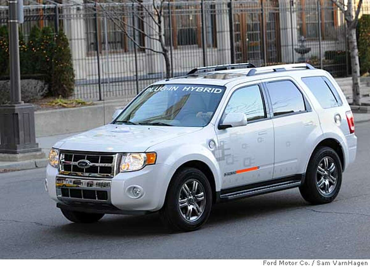 DETROIT, MI., January 2008 - Ford Escape Hybrid Plug In. The Ford Hybrid Escape Plug In offers outstanding fuel economy in urban areas. With a charged HV Battery, the gasoline engine rarely operates in these low speed conditions, resulting in fuel economy greater than 100 miles per gallon. Photo by: Sam VarnHagen/Ford Motor Co. Ran on: 03-28-2008 Ford Escape Hybrid that plugs in to charge its battery is now being tested in Los Angeles by Southern California Edison. Ran on: 03-28-2008 Ford Escape Hybrid that plugs in to charge its battery is now being tested in Los Angeles by Southern California Edison.