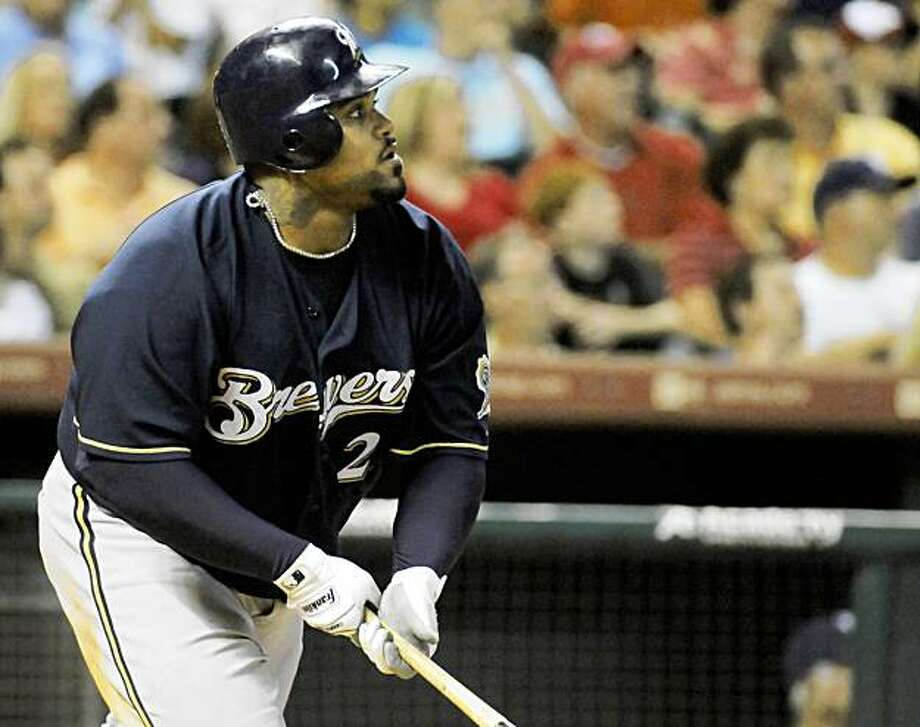 Milwaukee Brewers' Prince Fielder watches the ball go out for a two-run home run in the seventh inning against the Houston Astros in a baseball game Saturday, Aug. 8, 2009, in Houston. The Brewers won 12-5. (AP Photo/Pat Sullivan) Photo: Pat Sullivan, AP
