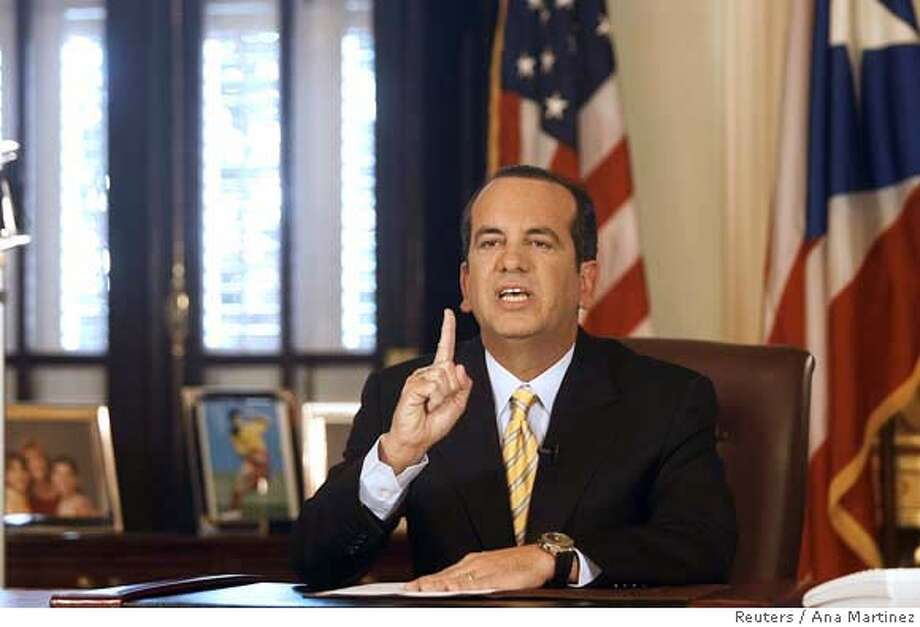 ###Live Caption:Governor of Puerto Rico Anibal Acevedo Vila addresses the state in the governor's office at La Fortaleza in San Juan, Puerto Rico March 27, 2008, denying all accusations charged by the U.S. attorney for election funding fraud. REUTERS/Ana Martinez (PUERTO RICO)###Caption History:Governor of Puerto Rico Anibal Acevedo Vila addresses the state in the governor's office at La Fortaleza in San Juan, Puerto Rico March 27, 2008, denying all accusations charged by the U.S. attorney for election funding fraud. REUTERS/Ana Martinez (PUERTO RICO)###Notes:Governor of Puerto Rico Acevedo Vila addresses the state in the governor's office at La Fortaleza in San Juan, Puerto Rico###Special Instructions: Photo: ANA MARTINEZ
