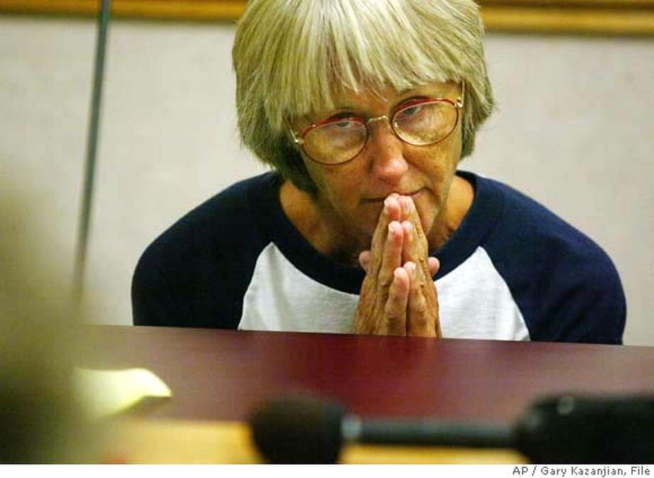 Sara Jane Olson reacts during a one-hour hearing Wednesday, 16,2002 at Central California Women's Facility, In Chowilla, Calif. The state's Board of Prison Terms ruled that the former Symbionese Liberation Army member must serve an additional five or more years in state prison for her role in a 1975 conspiracy to blow up Los Angeles police cars. The three-member board cited the potential for great violence and harm in the crime and Olson's later flight in its decision. (AP Photo/Gary Kazanjian) Photo: GARY KAZANJIAN