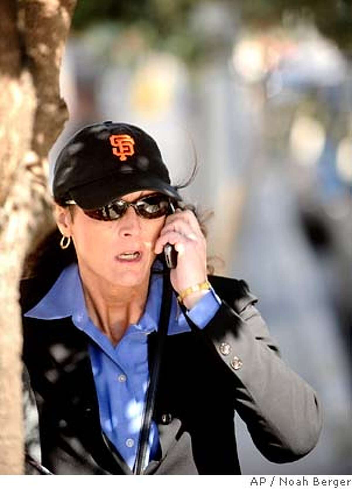 ###Live Caption:Former Olympic cyclist Tammy Thomas talks on her cell phone as she leaves the federal courthouse in San Francisco on Tuesday, March 25, 2008. Thomas is charged with perjury and obstruction of justice for allegedly lying to a federal grand jury investigating a steroid ring that spanned many sports. (AP Photo/Noah Berger)###Caption History:Former Olympic cyclist Tammy Thomas talks on her cell phone as she leaves the federal courthouse in San Francisco on Tuesday, March 25, 2008. Thomas is charged with perjury and obstruction of justice for allegedly lying to a federal grand jury investigating a steroid ring that spanned many sports. (AP Photo/Noah Berger)###Notes:Tammy Thomas###Special Instructions:
