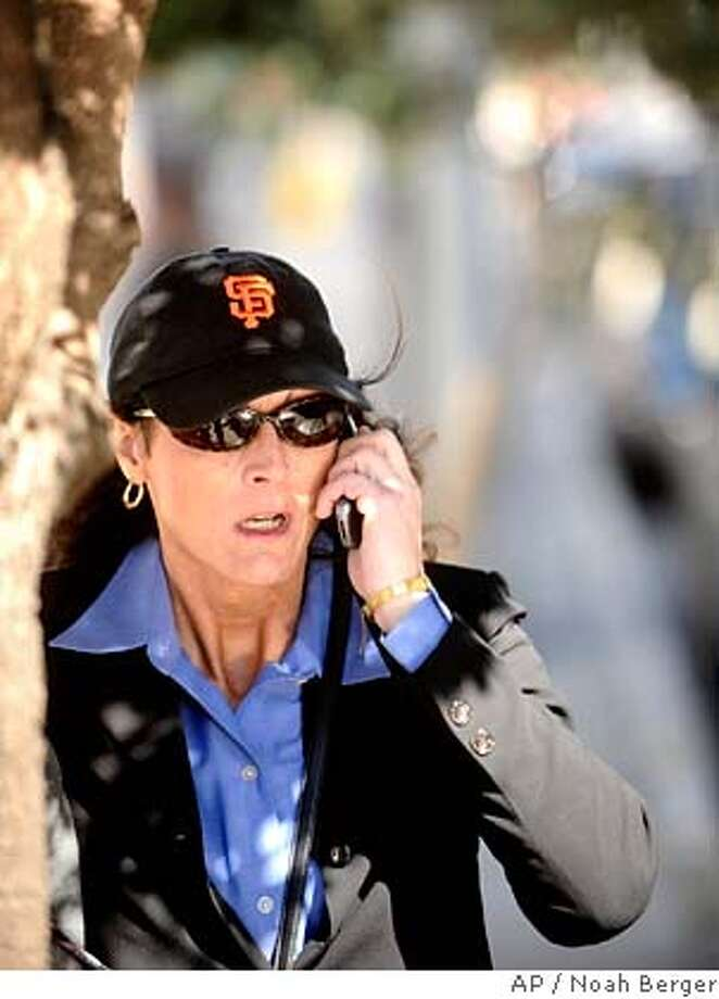 ###Live Caption:Former Olympic cyclist Tammy Thomas talks on her cell phone as she leaves the federal courthouse in San Francisco on Tuesday, March 25, 2008. Thomas is charged with perjury and obstruction of justice for allegedly lying to a federal grand jury investigating a steroid ring that spanned many sports. (AP Photo/Noah Berger)###Caption History:Former Olympic cyclist Tammy Thomas talks on her cell phone as she leaves the federal courthouse in San Francisco on Tuesday, March 25, 2008. Thomas is charged with perjury and obstruction of justice for allegedly lying to a federal grand jury investigating a steroid ring that spanned many sports. (AP Photo/Noah Berger)###Notes:Tammy Thomas###Special Instructions: Photo: Noah Berger