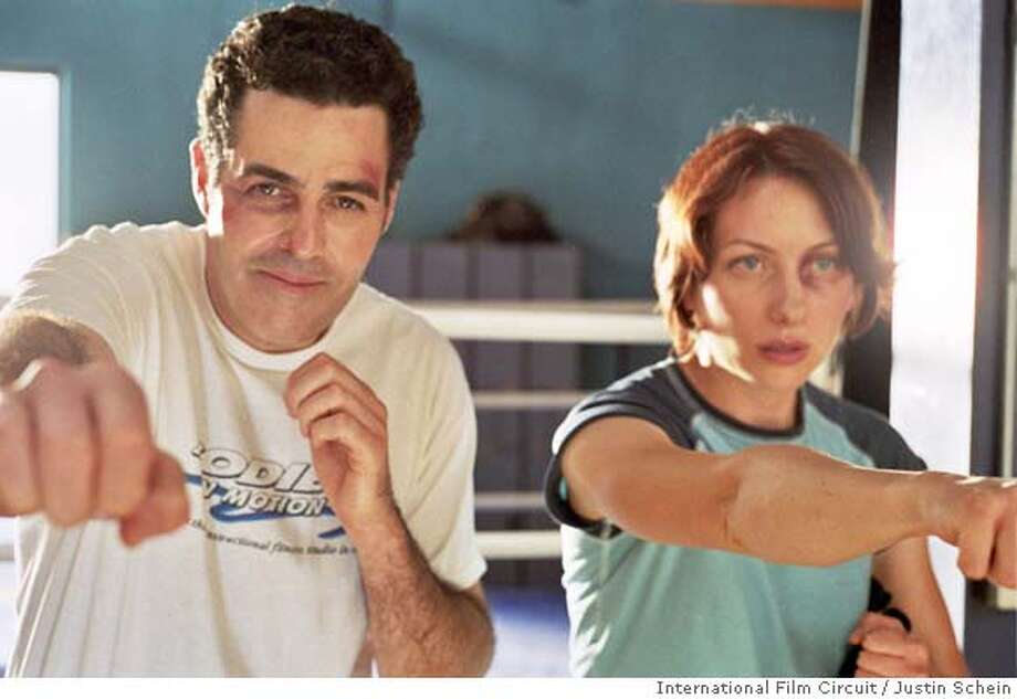 Adam Carolla as Jerry and Heather Juergensen as Lindsey in International Film Circuit's The Hammer. � by Justin Schein  Ran on: 03-21-2008  Adam Carolla and Heather Juergensen get physical at the gym in &quo;The Hammer.&quo; Photo: Justin Schein