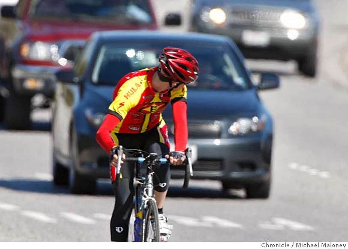 ###Live Caption:A cyclist looks back at the approaching traffic on Sand Hill Road in Menlo Park, Calif. Photo taken on March 20, 2008. Photo by Michael Maloney / San Francisco Chronicle###Caption History:A cyclist looks back at the approaching traffic on Sand Hill Road in Menlo Park, Calif. Bicyclists were twice as likely as drivers to be