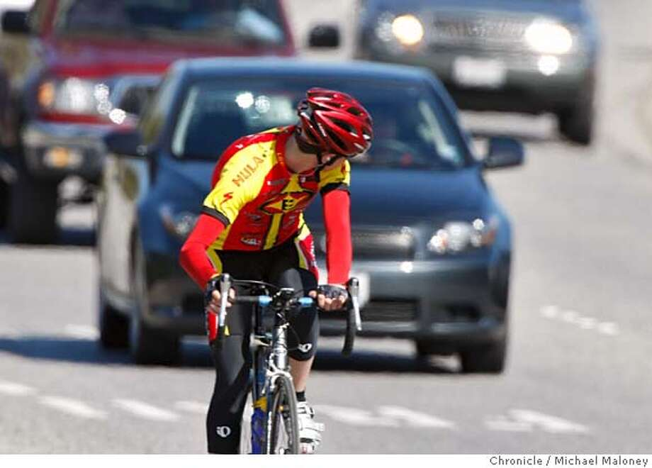 "###Live Caption:A cyclist looks back at the approaching traffic on Sand Hill Road in Menlo Park, Calif. Photo taken on March 20, 2008.  Photo by Michael Maloney / San Francisco Chronicle###Caption History:A cyclist looks back at the approaching traffic on Sand Hill Road in Menlo Park, Calif.  Bicyclists were twice as likely as drivers to be ""at fault"" in the more than 2,000 collisions that killed or severely injured bay area bike riders in the last decade. Photo by Michael Maloney / San Francisco Chronicle###Notes:***###Special Instructions:MANDATORY CREDIT FOR PHOTOG AND SAN FRANCISCO CHRONICLE/NO SALES-MAGS OUT Photo: Michael Maloney"