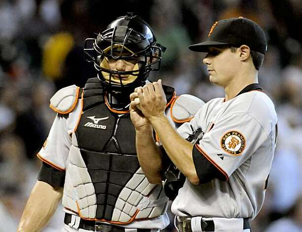 San Francisco Giants catcher Eli Whiteside, left, talks with pitcher Joe Martinez in the second inning against the Houston Astros in a baseball game Wednesday, Aug. 5, 2009, in Houston. (AP Photo/Pat Sullivan) Photo: Pat Sullivan, AP