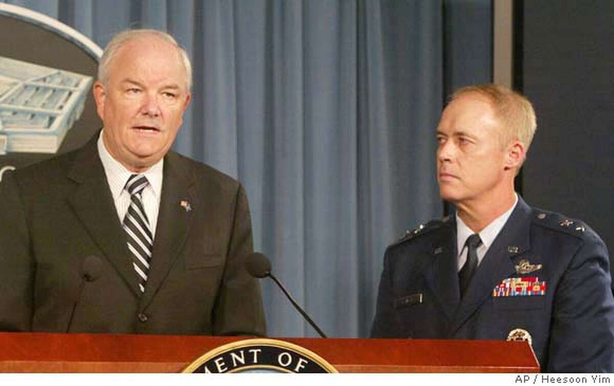 ###Live Caption:Ran on: 10-20-2007 Air Force Secretary Michael Wynne speaks at a news conference as Maj. Gen. Richard Newton, deputy chief of staff, looks on.###Caption History:Air Force Deputy Chief of Staff Maj. Gen. Richard Newton III, right, looks on as Air Force Secretary Michael Wynne speaks during a news conference at the Pentagon, Friday, Oct. 19, 2007. In its first explicit confirmation that nuclear-armed missiles were erroneously flown from an air base in North Dakota to a base in Louisiana in late August, the Air Force on Friday called the episode an