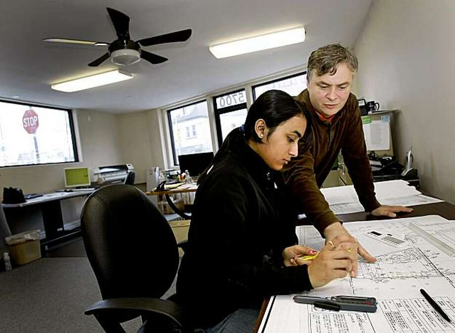 Business owner Brendan Murphy (right) explains a measuring device to intern Rupinder Kaur. Rupinder Kaur is one of the lucky high school students who got a paid internship this summer.  She is working at Kingdom Pipeline in San Francisco, CA. Photo: Brant Ward, The Chronicle