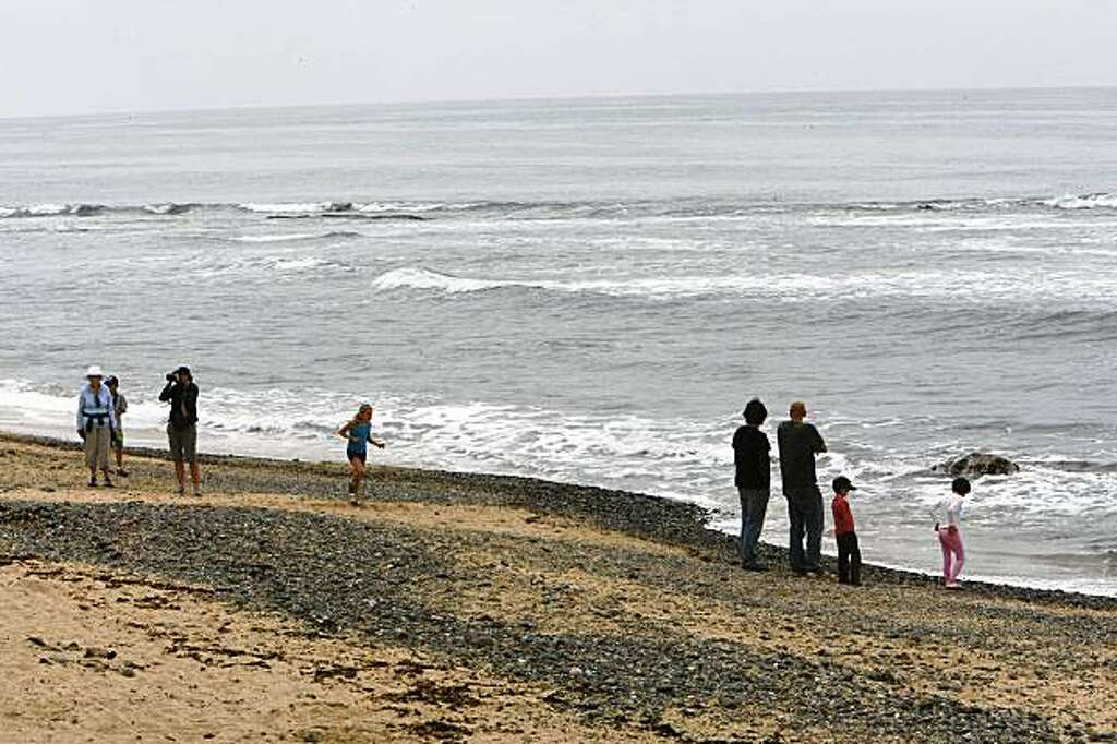 Visitors Stroll Along Moss Beach In Half Moon Bay Calif On August 5