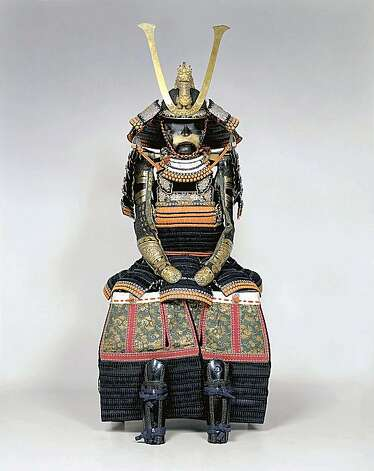 "A samurai's suit of armor, on exhbit as part of the Asian Art Museum's ""Lords of the Samurai"" exhibit.  PERMISSION IS GRANTED TO REPRODUCE THIS IMAGE SOLELY IN CONNECTION WITH A REVIEW OR EDITORIAL COMMENTARY ON THE LORDS OF THE SAMURAI EXHIBITION AT THE ASIAN ART MUSEUM JUNE 12 - SEPTEMBER 20, 2009. ALL OTHER REPRODUCTIONS ARE STRICTLY PROHIBITED WITHOUT THE PRIOR WRITTEN CONSENT OF THE COPYRIGHT HOLDER AND/OR MUSEUM.  Haramaki-type armor, black leather lacing, red cord horizontal accent lacing (katadori) on shoulder protectors, worn by Hosokawa Narimori (1806–1861), Japan. Edo period (1615–1868), 19th century. Iron, leather, lacquer, silk, and gilt metal. Eisei-Bunko Museum, 4111. © Eisei Bunko, Japan. Photo: Courtesy, Asian Art Museum"