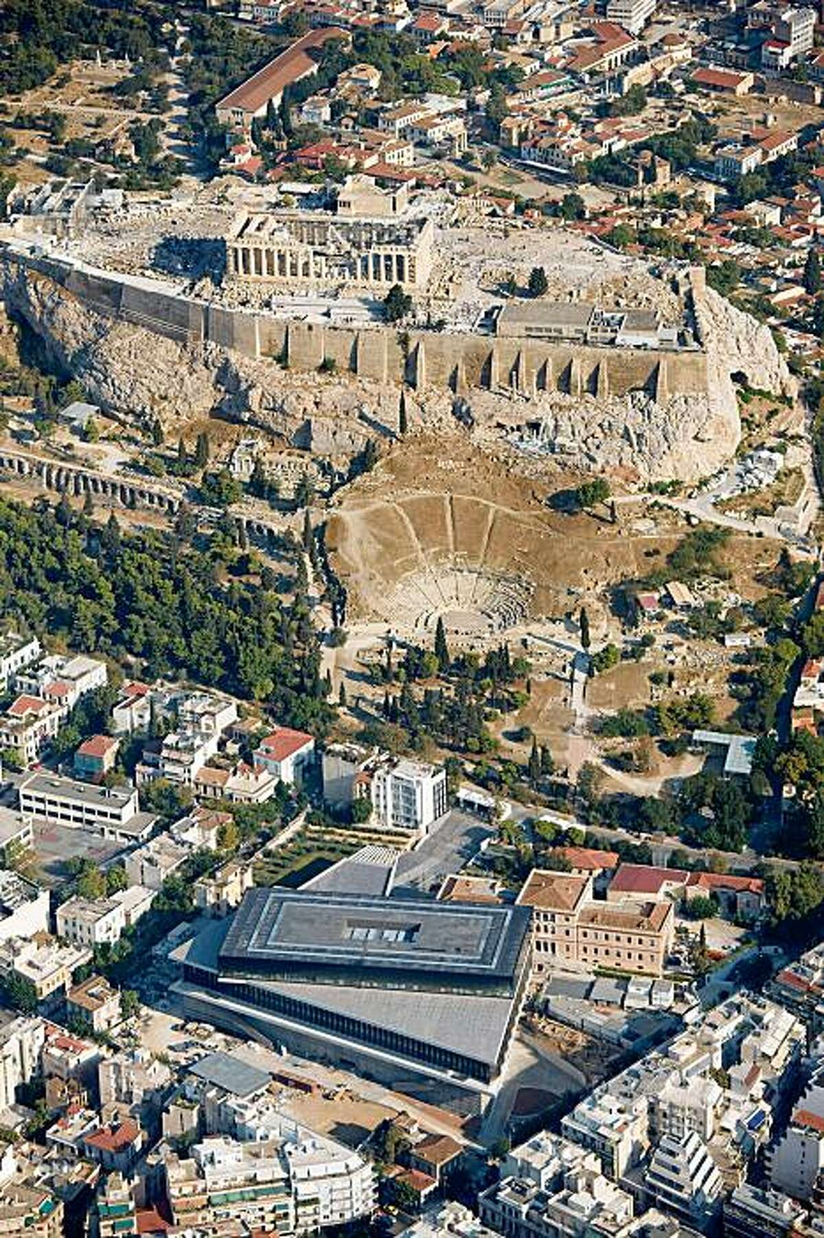 Aerial view of the New Acropolis Museum, Athens, Greece, designed by Bernard Tschumi, showing relationship to the Acropolis and Parthenon.