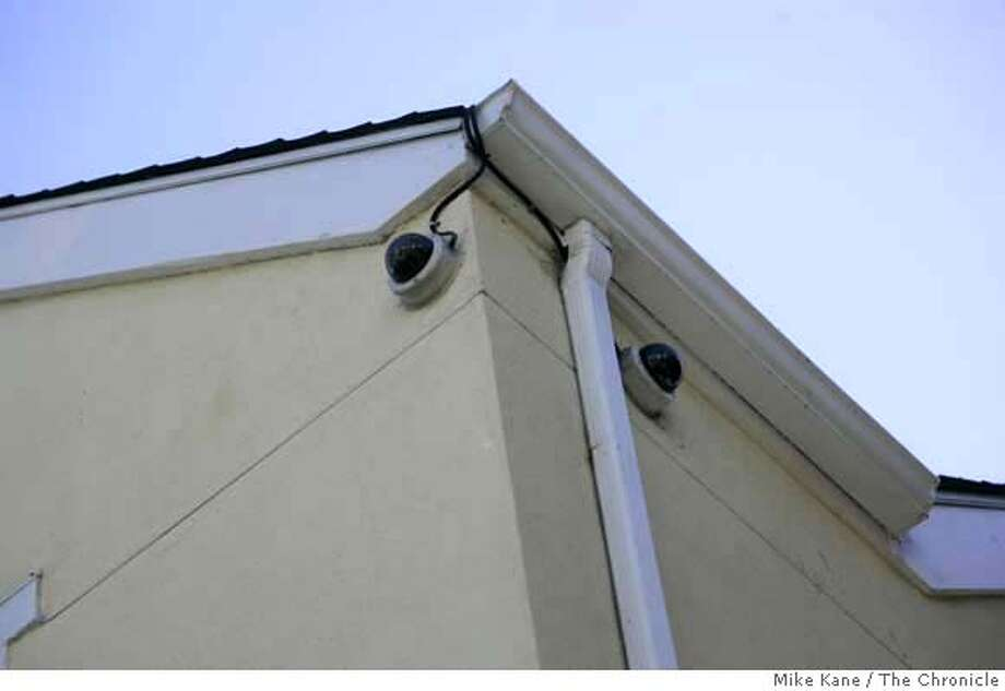 Security cameras record activity in a SFHA housing project at the corner of Eddy and Laguna in San Francisco. Photo: MIKE KANE