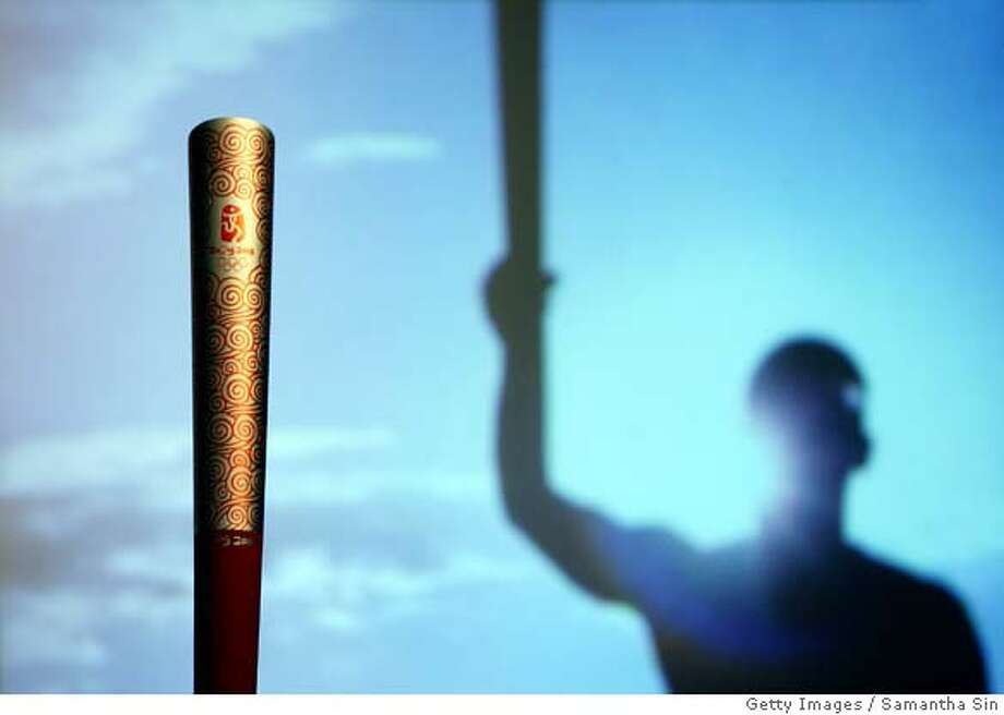 The Beijing 2008 Olympic Torch is unveiled during a press conference in Hong Kong, 13 August 2007. The torch for the Beijing 2008 Olympic Games is designed by Lenovo, and the torch relay will carry the torch from city to city around the world until it arrives at its final destination in Beijing on 08 August 2008 to mark the start of the Beijing 2008 Olympic Games. AFP PHOTO/Samantha SIN (Photo credit should read SAMANTHA SIN/AFP/Getty Images) (Newscom TagID: gettylive942331) [Photo via Newscom]  Ran on: 03-12-2008 Ran on: 03-12-2008 Ran on: 03-20-2008 Photo: SAMANTHA SIN