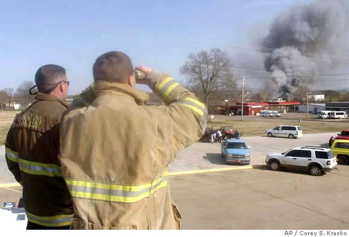###Live Caption:Fort Smith, Ark. firefighters Chris Taylor, left, and James Wood watch from the roof of a fire truck as smoke billows from the Cargill Meat Processing plant in Booneville, Ark. on Sunday, March 23, 2008. Because of the threat of leakage of potentially deadly anhydous ammonia, used as a refrigerant at the 150,000 square-foot facility, firefighters were pulled back from the scene and residents within a 2-mile radius were evacuated from their homes. (AP Photo/Times Record, Corey S. Krasko)###Caption History:Fort Smith, Ark. firefighters Chris Taylor, left, and James Wood watch from the roof of a fire truck as smoke billows from the Cargill Meat Processing plant in Booneville, Ark. on Sunday, March 23, 2008. Because of the threat of leakage of potentially deadly anhydous ammonia, used as a refrigerant at the 150,000 square-foot facility, firefighters were pulled back from the scene and residents within a 2-mile radius were evacuated from their homes. (AP Photo/Times Record, Corey S. Krasko)###Notes:Chris Taylor, James Wood###Special Instructions: