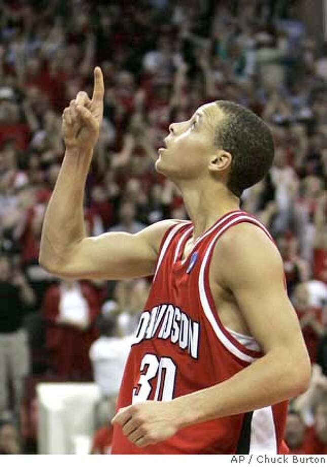 ###Live Caption:Davidson's Stephen Curry (30) points upward after scoring a basket against Georgetown in the second half of a second-round NCAA Midwest Regional basketball game in Raleigh, N.C., Sunday, March 23, 2008. Davidson won 74-70. (AP Photo/Chuck Burton)###Caption History:Davidson's Stephen Curry (30) points upward after scoring a basket against Georgetown in the second half of a second-round NCAA Midwest Regional basketball game in Raleigh, N.C., Sunday, March 23, 2008. Davidson won 74-70. (AP Photo/Chuck Burton)###Notes:Stephen Curry###Special Instructions:EFE OUT Photo: Chuck Burton