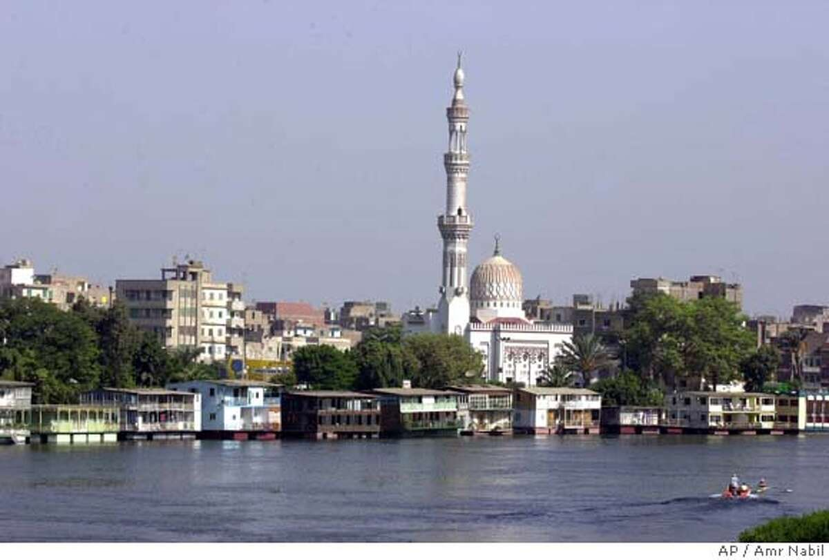 TRAVEL CAIRO HOUSEBOATS -- A general view of Cairo's Nile houseboats and the adjacent suburb of Kit Kat and its landmark mosque, Aug.31, 2002. Egypt's Nobel Prize laureate Naguib Mafhouz used the houseboats as the setting for his 1966 novel, Adrift on the Nile.(AP Photo/Amr Nabil) Ran on: 06-10-2007 Although 85 percent of the Niles water originates in Ethiopia, Egypt (above) uses 75 percent of it. Ran on: 06-10-2007